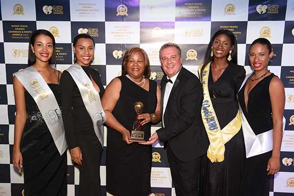 Turks & Caicos Minister of Tourism, Hon. Porsha Stubbs-Smith accepting the 'Caribbean's Leading Beach Destination' award from Chris Frost, VP of World Travel Awards